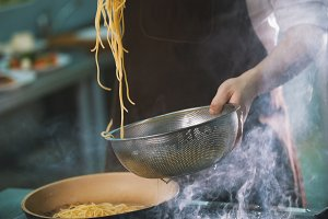 Process of cooking spaghetti in restaurant