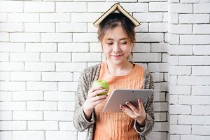 Healthy Young Woman Reading Tablet