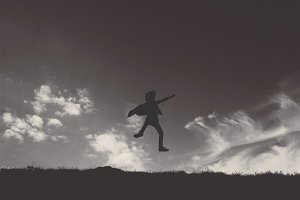 Little Boy Jumping on a Hill