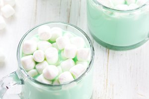 Hot white mint chocolate with marshmallows, white background. Holidey drink