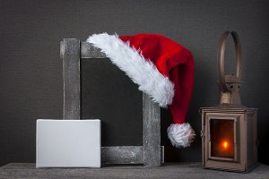 Red Santa Claus hat and an old woode