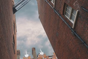 Facades of brick houses in London