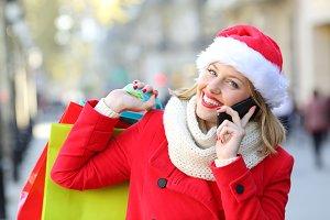 Happy shopper wearing santa hat