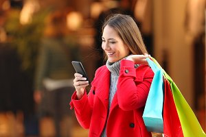 Happy shopper using a smartphone