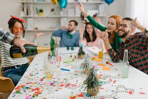 Rooting for champagne at holidays office party