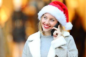 Happy woman wearing santa hat