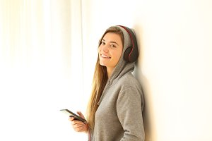 happy teen listening to music