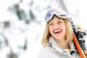 happy skier holding skis