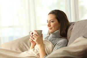 tenant resting holding a coffee mug