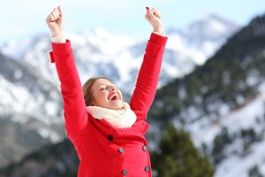 Excited woman wearing a red jacket
