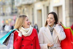 Two happy shoppers talking