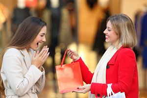 happy shopper giving a gift