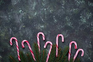 Christmas background with candy cane and fir tree branches
