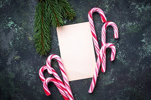 Christmas background with candy cane and letter