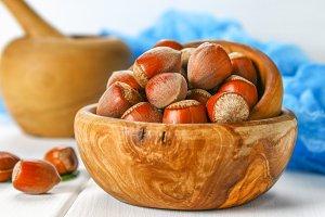 Walnut hazelnut in a bowl on a white