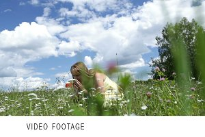 Girl is dancing in the field