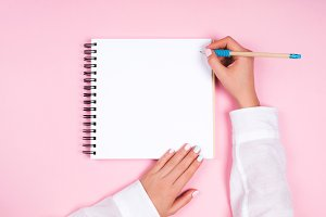 Spiral notepad with pencil as mockup for design