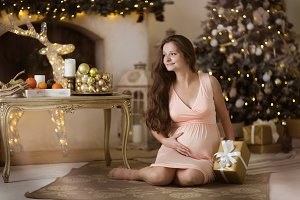 pregnant woman near Christmas tree