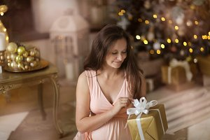 pregnant near Christmas tree