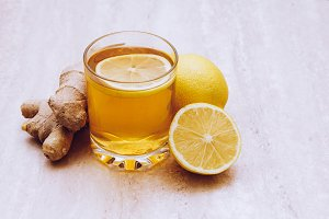 Cup of ginger tea with lemon.