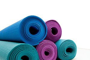Background for banner. Yoga mat isolated on white background. copyspace.