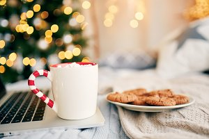 Christmas cookies with cup of hot coffee