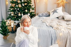 Happy smiling girl woman in Christmas atmosphere. Christmas holiday