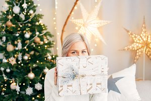 Happy smiling girl woman with christmas gift box. Christmas atmosphere