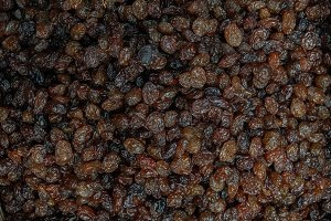 Background of lined dark raisins.