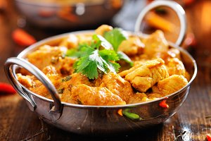 indian chicken curry in batli dish