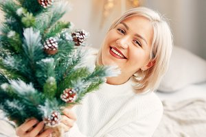 Happy smiling girl woman in Christmas atmosphere. Christmas holiday.