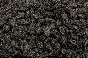 Background of lined dark raisins.