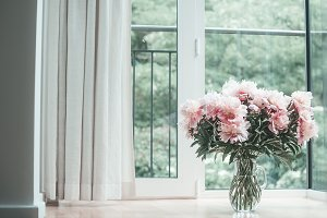 Cozy home with bouquet of peonies