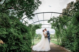 Gorgeous newlyweds hug each other