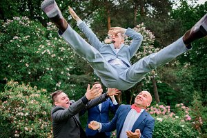 Groomsmen throw groom up