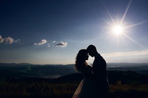 Silhouettes of wedding couple