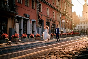 Bride and groom run