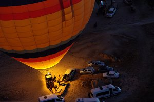 Colorful hot air balloons preparing for flying over Red valley at Cappadocia