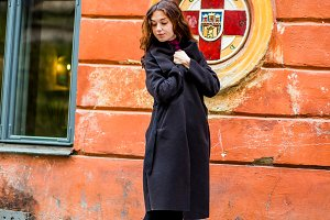 Stylish girl in black coat