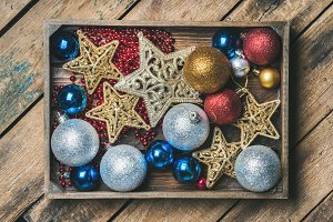 Christmas tree toy stars, balls and garland in wooden box