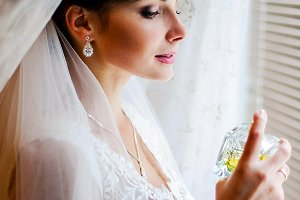 Sweet bride posing by the window