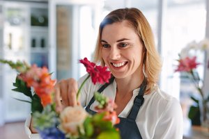 Smiling female florist preparing