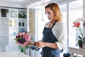 Woman florist arranging
