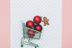 grocery cart with red balls