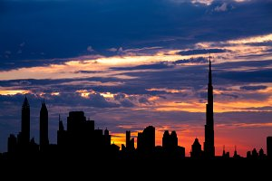 Dubai cityscape silhouette on sunset