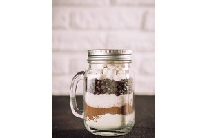 Hot chocolate mix in mason jar with copy space