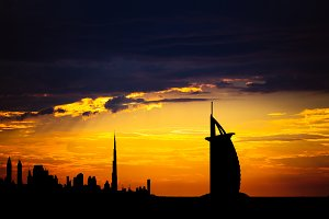 Dubai cityscape silhouette on sunset