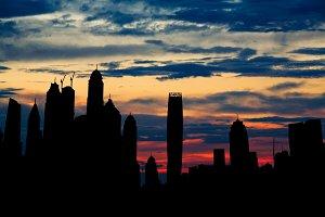 Dubai marina cityscape silhouette on sunset