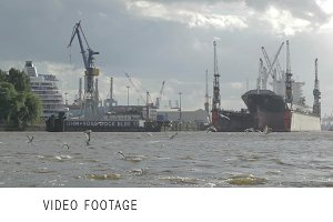 Hamburg port. Cargo ship, gulls.