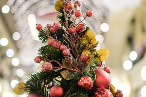 Photo of decorated Christmas tree with red and gold ornaments